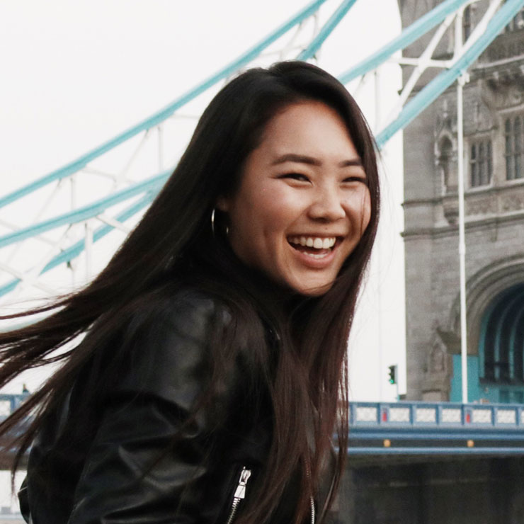 Woman smiling on a windy day in London.