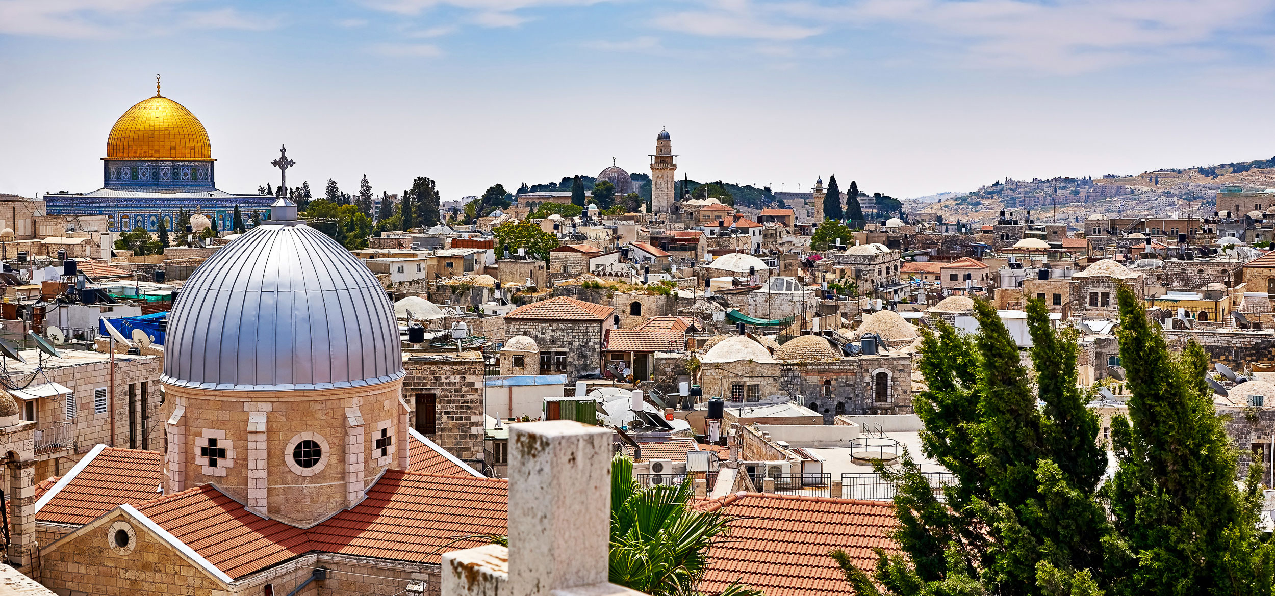 Aerial view of Jerusalem, Israel, with the golden Dome of the Rock on the Temple Mount in the background.