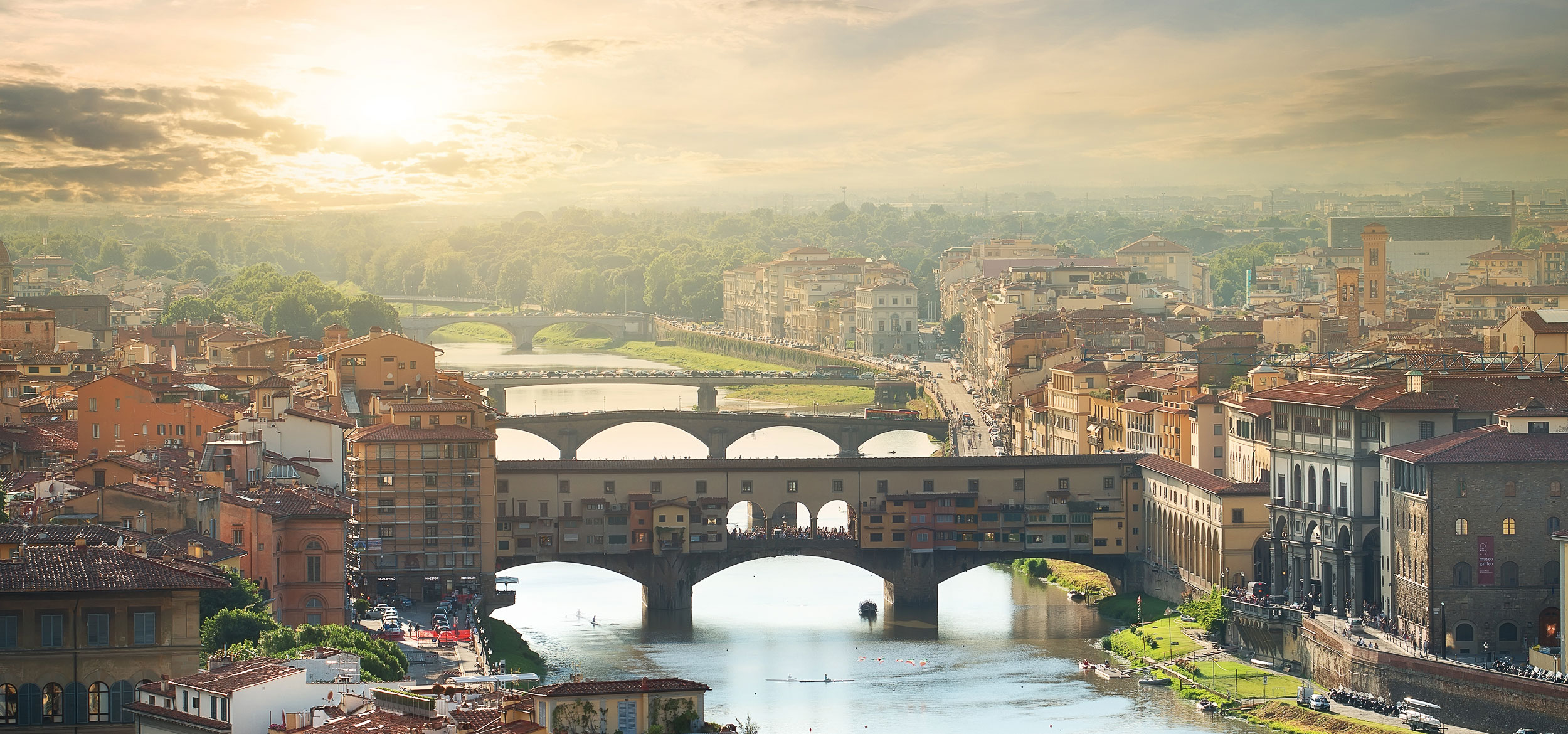 View of the Ponte Vecchio Bridge over the Arno River in Florence, Italy.