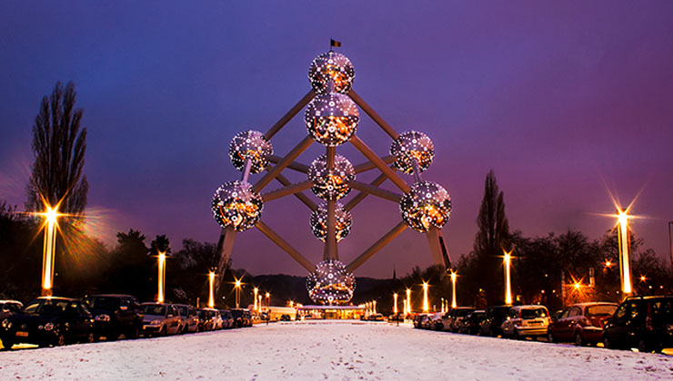 Molecule structure with a purple sky and snow in Brussels Belgium.