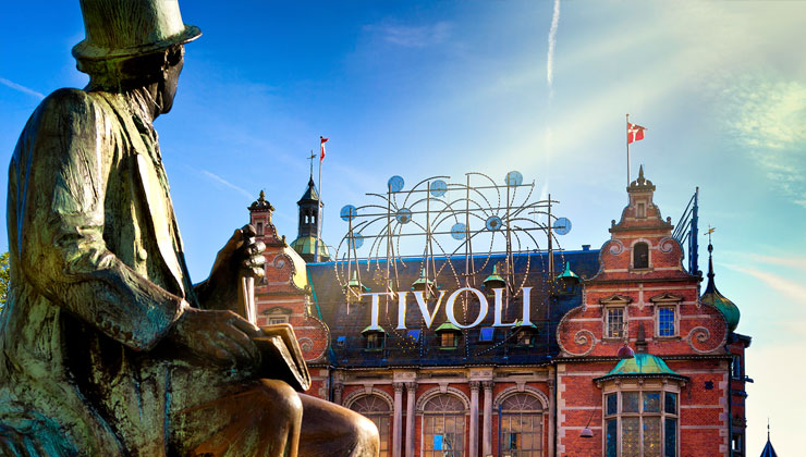 Tivoli Gardens with statue in foreground in Copenhagen, Denmark.