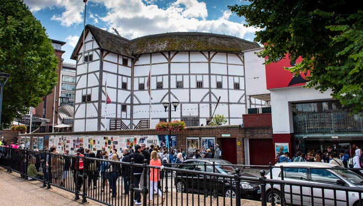 Pedestrians outside Shakespeare's Globe Theater in London, England.