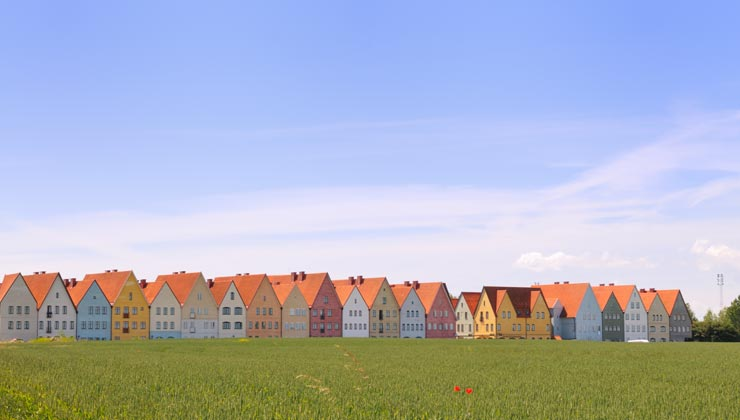 Jakriborg and colorful houses near a grassy field in Lund, Sweden.