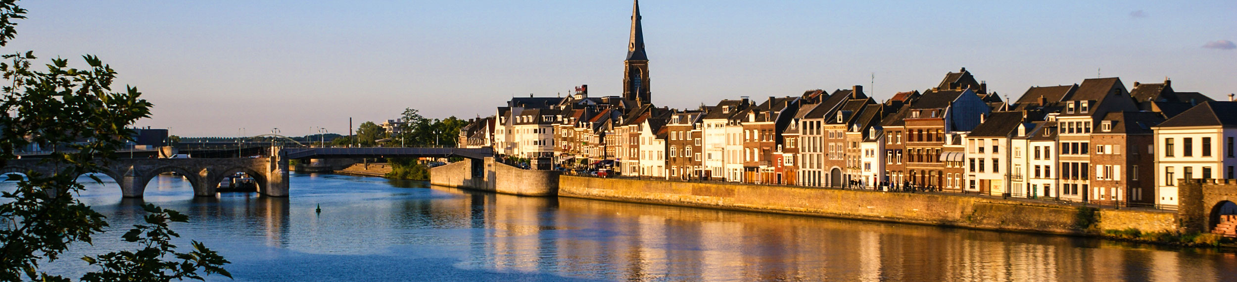 Maas River and buildings near the water in Maastricht, Netherlands.