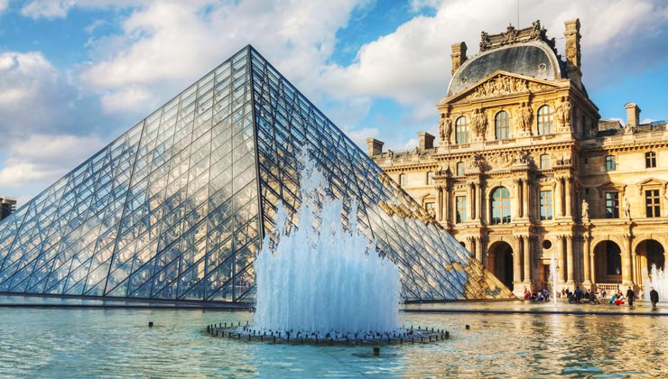 The The Louvre with the glass pyramid and fountain.