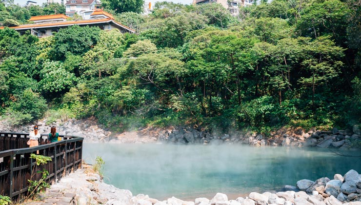Beitou hot springs with trees and a viewing area in Taipei, Taiwan.