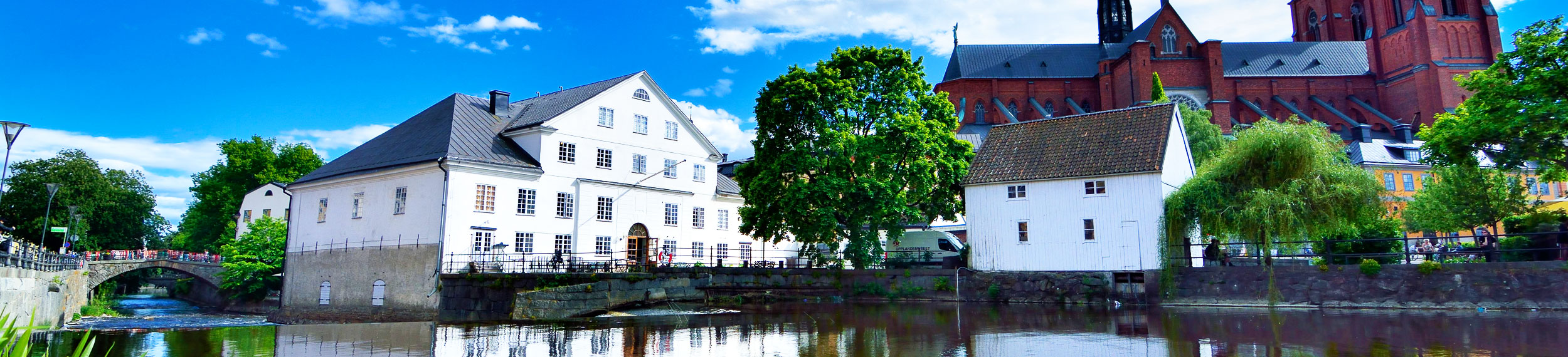 View of Uppsala Cathedral and buildings near the river in Uppsala Sweden.