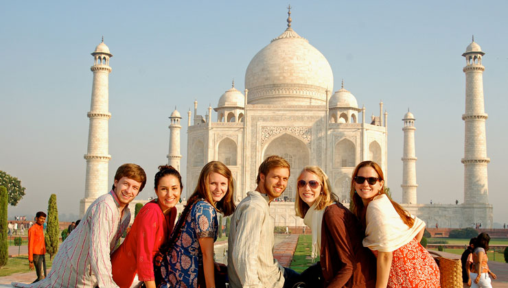 UCEAP students smile for the camera with the Taj Mahal in Agra, India, in the distance.