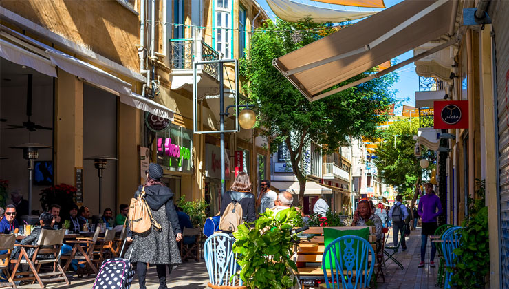 People enjoying a summer day at cafes on Ledra Street in Nicosia, Cyprus.