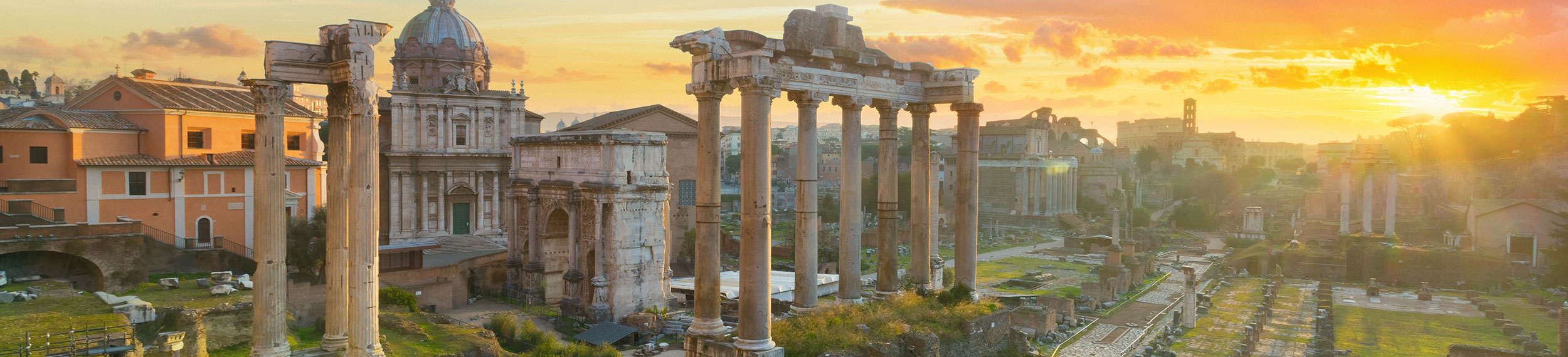 View of the Ruins of Roman Forum during sunrise with the Arch of Septimius Severus, the Temple of Saturn, the colonnade of Basilica Julia, and the Temple of Castor and Pollux in Rome, Italy.