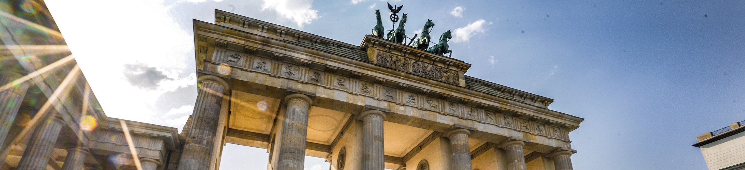 Low angle view of Brandenburg Gate on a sunny day in Berlin, Germany.
