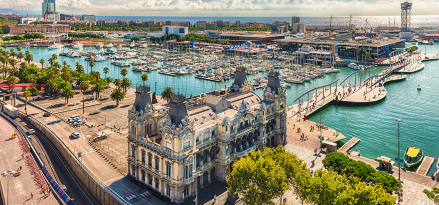 Aerial view of the Port Authority- Admiral Historic Authority building with the Port Vell harbor in the background in Barcelona, Spain.