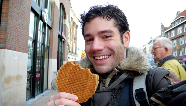 A student eating a Stroopwafel in The Netherlands.