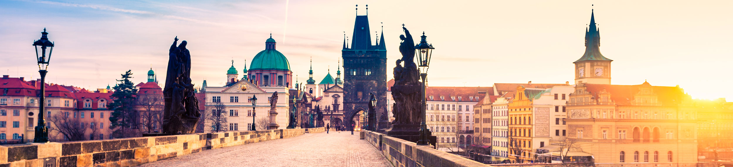 View of Charles Bridge and city skyline in Prague, Czech Republic.