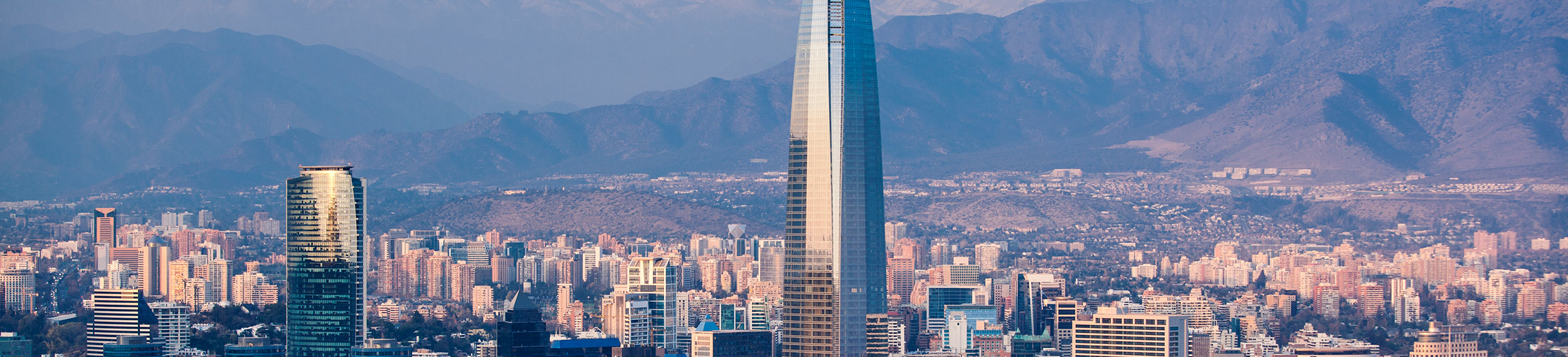 Aerial view of the financial district with mountains in the background in Santiago, Chile.