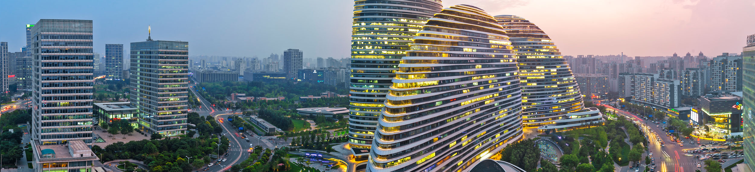 Aerial shot of three curvilinear asymmetric skyscrapers and Wangjing skyline in Beijing China.