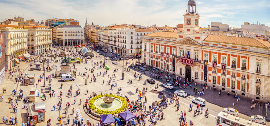 City square with fountain, Puerta del Sol, Madrid Spain