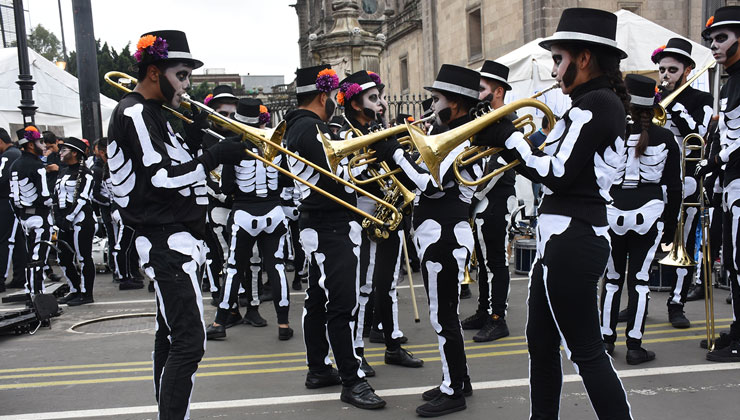 Musicians dressed in skeleton costume participate in a parade for Day of the Dead in Zocalo Square in Mexico City, Mexico.