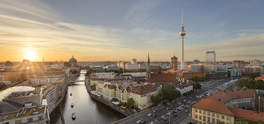 View of the Television tower, the Red Town Hall, Berlin Cathedral and Berlin skyline along the river Spree in Germany.
