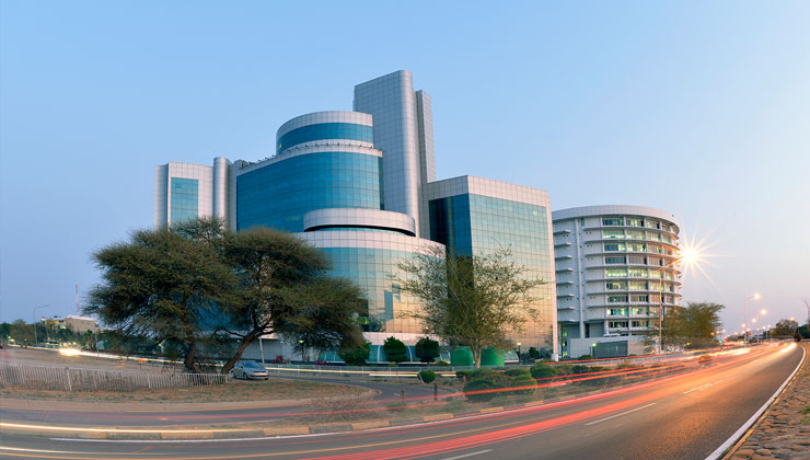 City buildings and busy highway in Gaborone, Botswana.