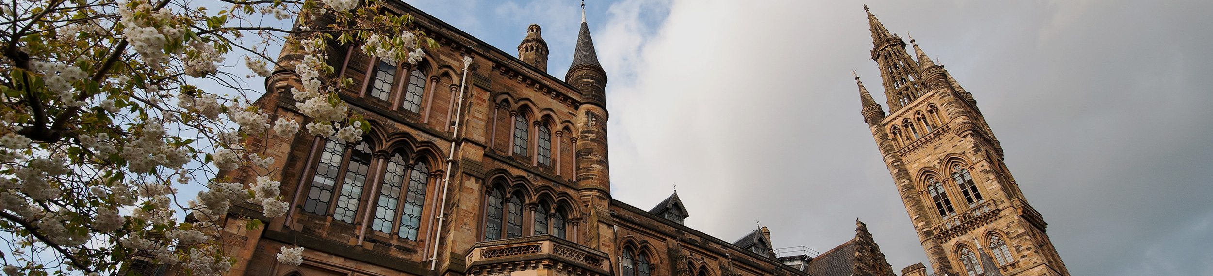 Looking up at the exterior of the main building of the University of Glasgow, Scotland.