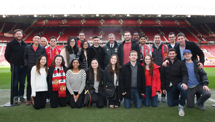 Study abroad students including UCEAP students at a Manchester United game in Manchester, England