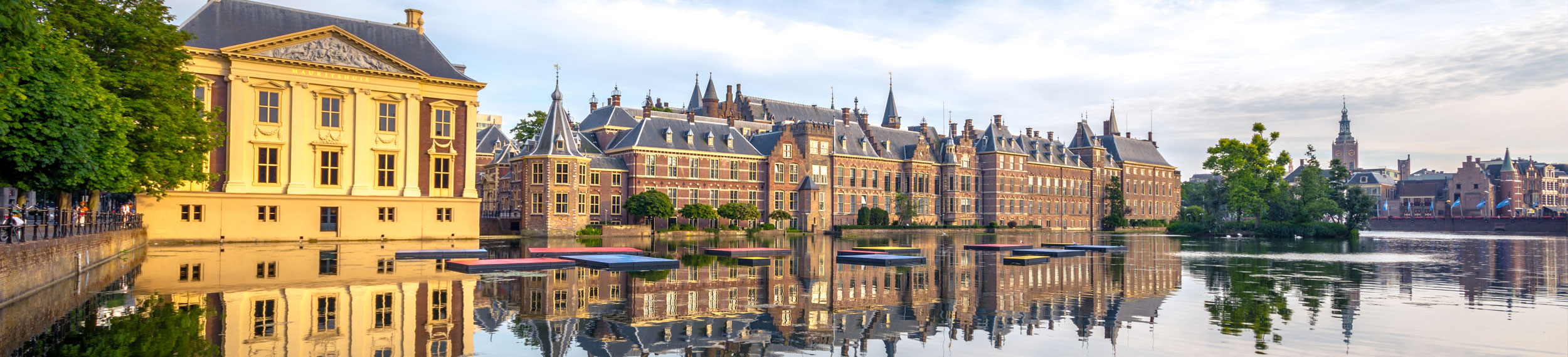 Landscape shot of the Hofvijver Pond (Court Pond) with the Binnenhof complex in The Hague, Netherlands