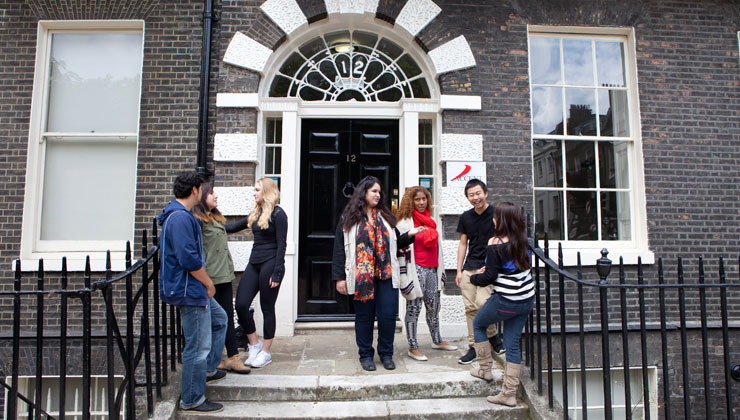 Study abroad students including UCEAP students standing outside the ACCENT London study center.