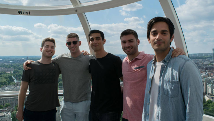 Study abroad students including UCEAP students smiling for the camera on the London Eye in London, England.