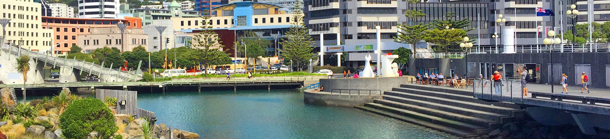 View of a waterfront area with modern buildings in the background in Wellington, New Zealand