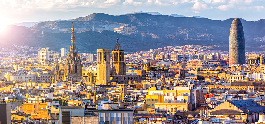 Barcelona skyline with a view of Cathedral of Barcelona and Torre Agbar in the distance in Barcelona, Spain.