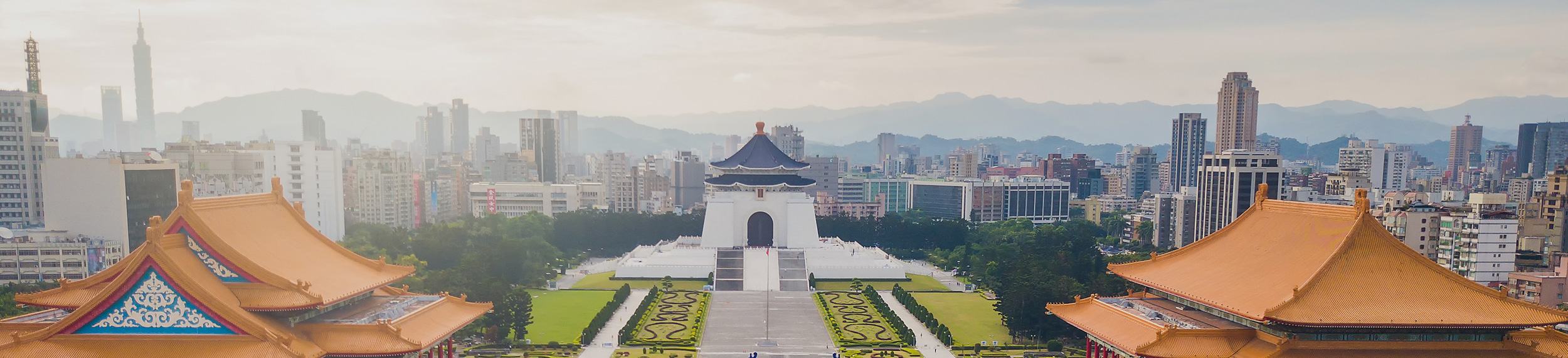 aerial sunrise view from drone of Chiang Kai-Shek Memorial Hall with taipei city