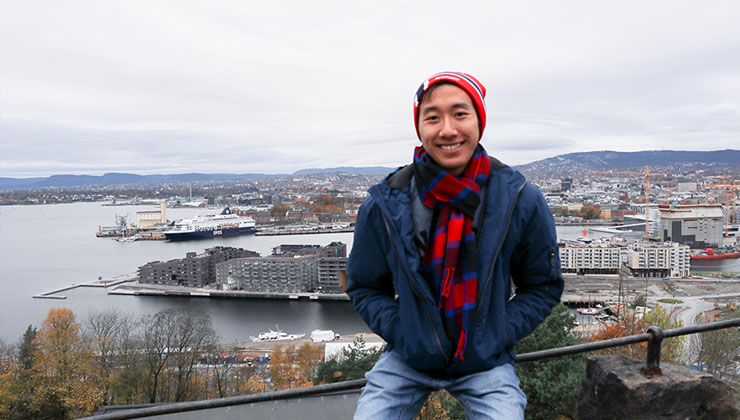 UC Los Angeles student smiles and enjoys the view of the water in Ekeberg, Norway.