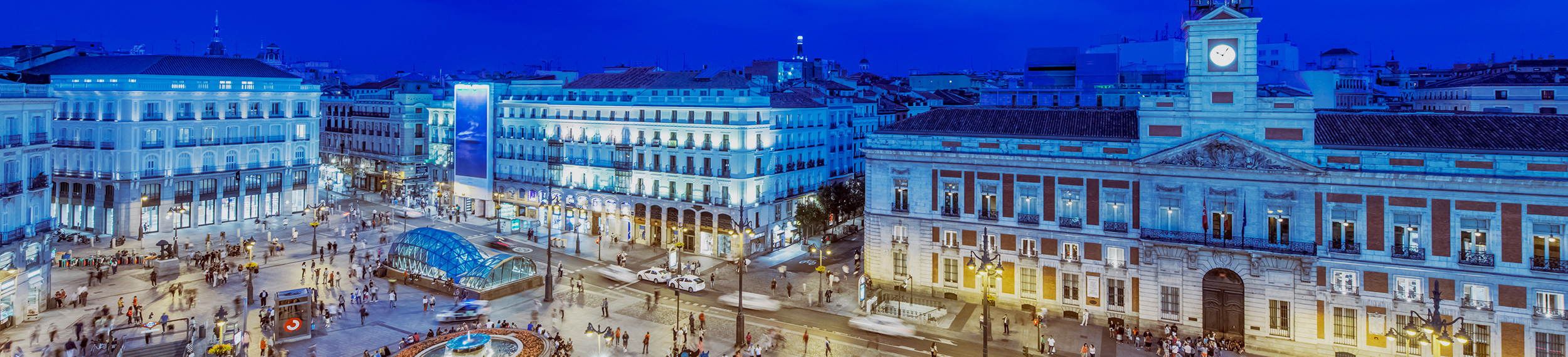 Ornate buildings illuminated at night, Madrid