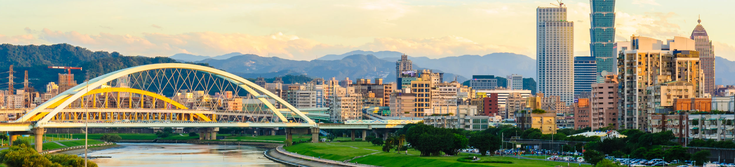 Landscape shot of a bridge over the Tamsui River and city buildings in Taipei, Taiwan