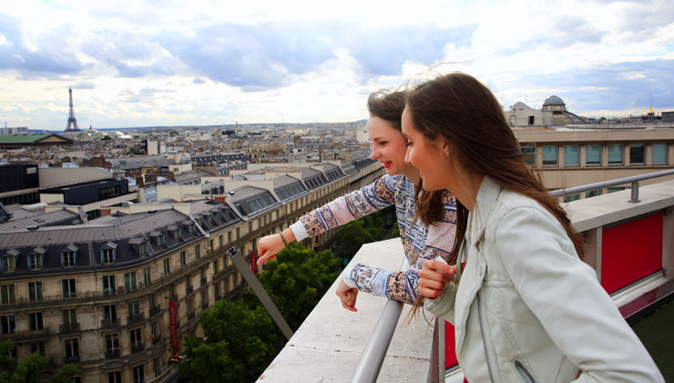 Students looking out city streets with the Eiffel Tower in the background, Paris, France.