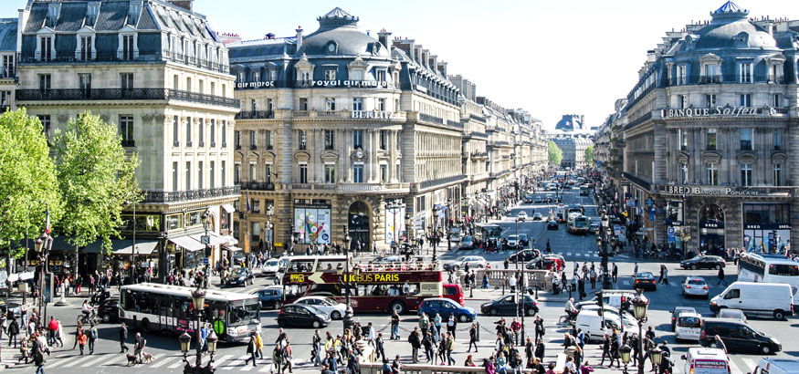 A shot of cars, buses and pedestrians in the streets of Paris, France.