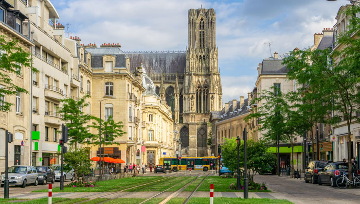 A city shot with a view of Cathédrale Notre-Dame de Reims in Reims, France.