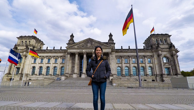 UC Riverside student stands in front of the Reichstag Building in Berlin, Germany.