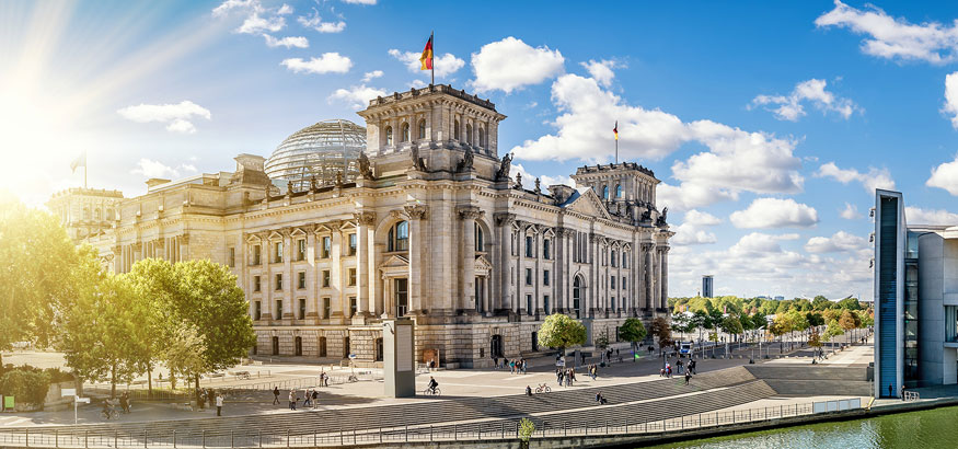 View of the Reichstag along the Spree River on a beautiful summer day in Berlin, Germany.
