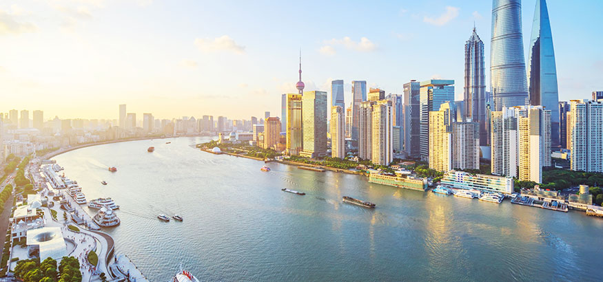 Aerial shot of skyscrapers and a view of the Huangpu River in Shanghai, China.