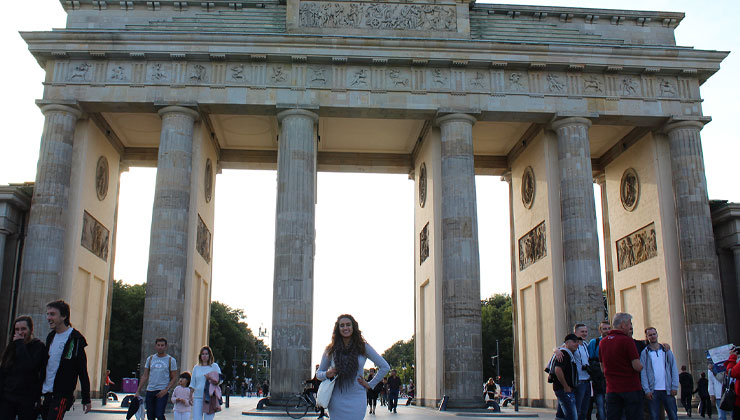 UC Santa Cruz student standing in front of the Brandenburg Gate in Berlin, Germany.