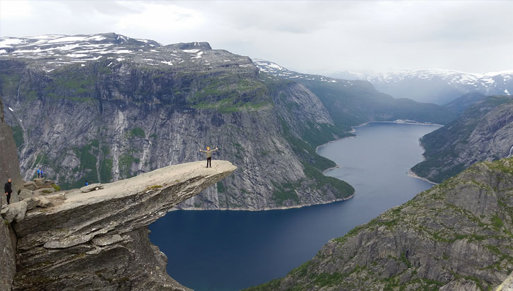 UC Santa Barbara student stands on the Trolltunga mountain Oslo, Norway.