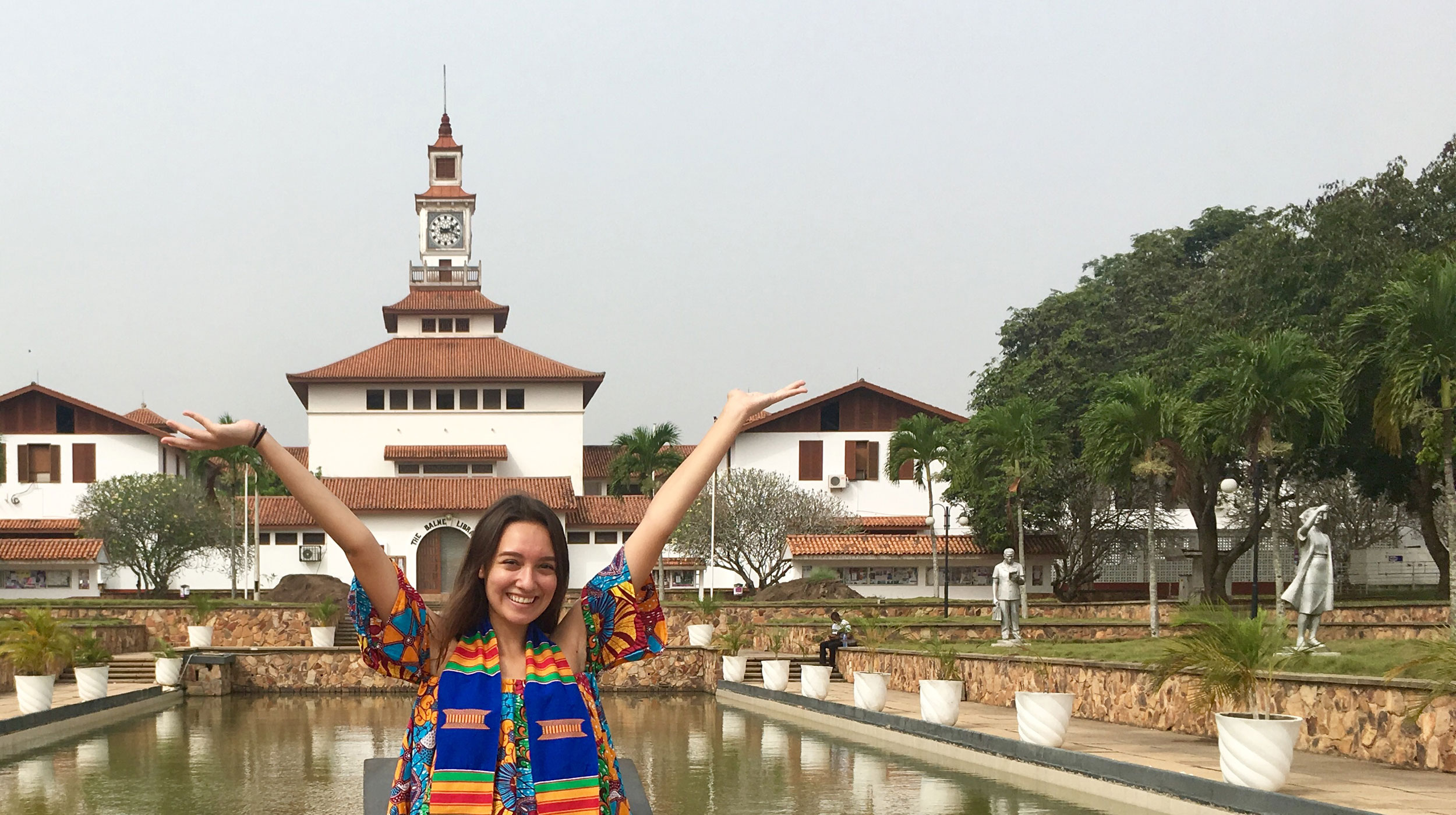 UCEAP student smiling with her arms up in Ghana.