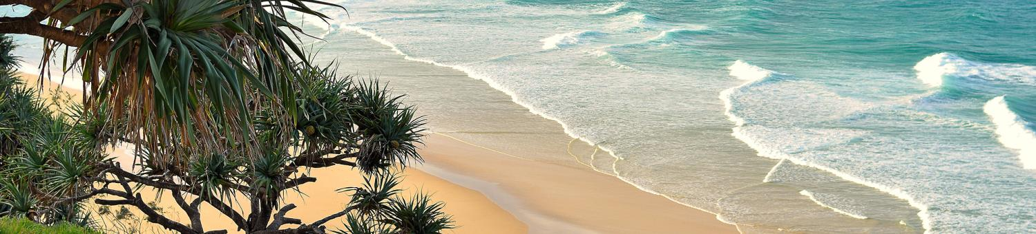 North Stradbroke Island beach with turquoise water on a beautiful day in Queensland, Australia.