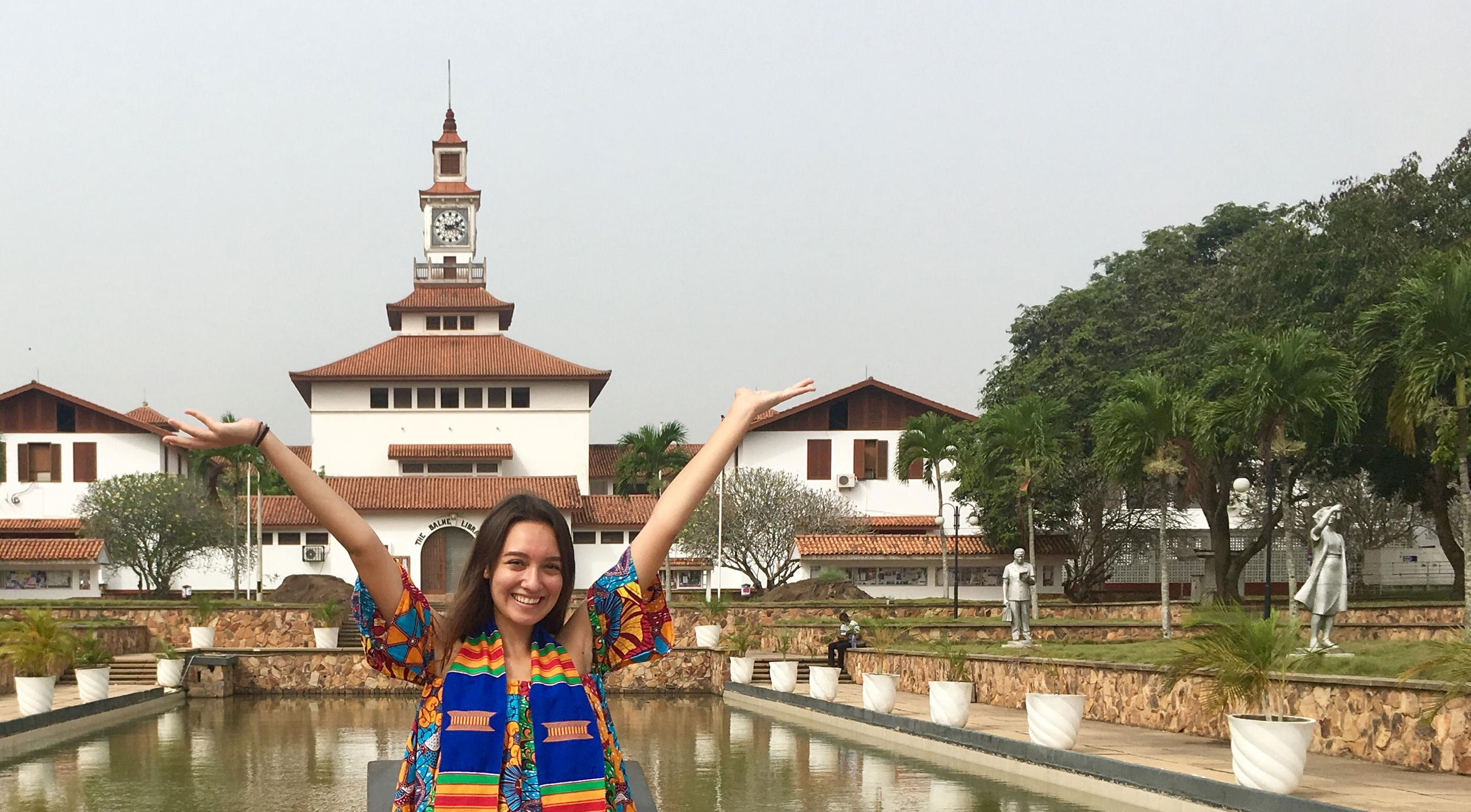 UCEAP student smiling with her arms in the air in Accra, Ghana